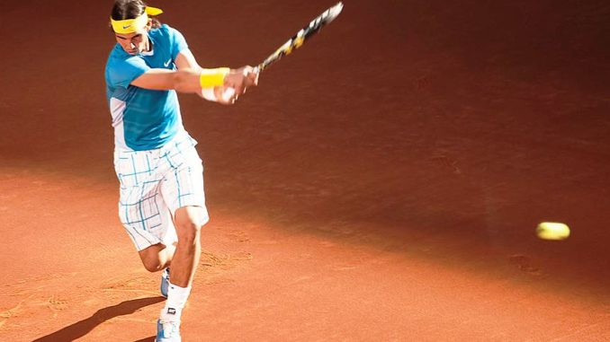 Rafael Nadal Plays Tennis with Fan